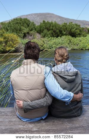 Happy couple at a lake in the countryside