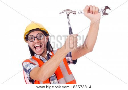 Funny young construction worker with hammer and wrench isolated on white