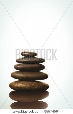Zen stones balancing on white background shot in studio