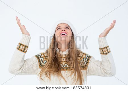 Smiling hipster looking above her head on white background