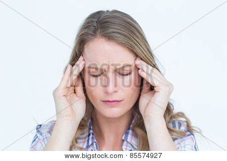 Pretty hipster with headache on white background