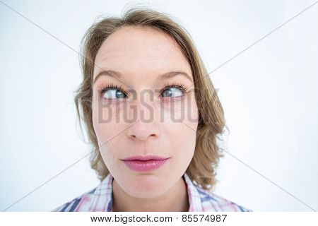 Funny hipster grimacing on white background