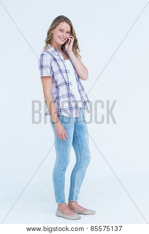 Pretty hipster calling with her smartphone on white background
