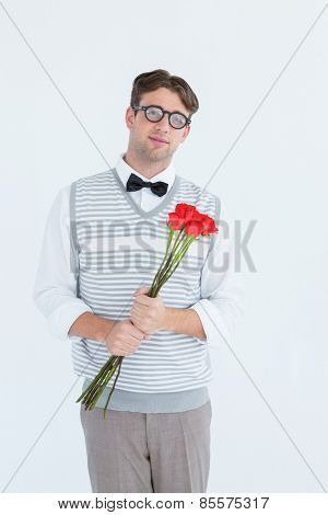 Geeky hipster offering bunch of roses on white background