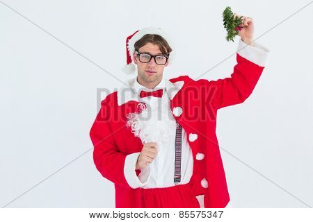 Geeky hipster in santa costume holding mistletoe on white background