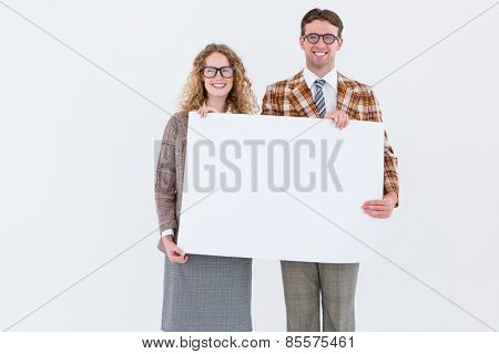 Geeky hipster couple holding poster on white background