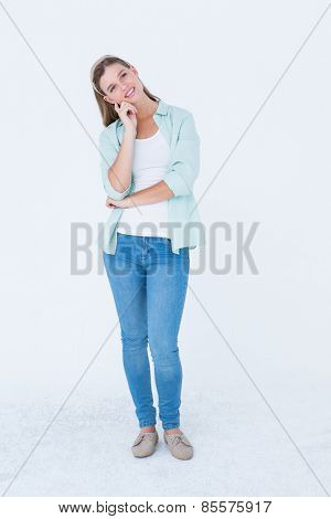 Thoughtful pretty hipster on white background