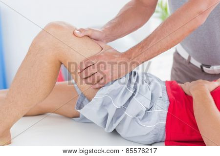 Man having thigh massage in medical office