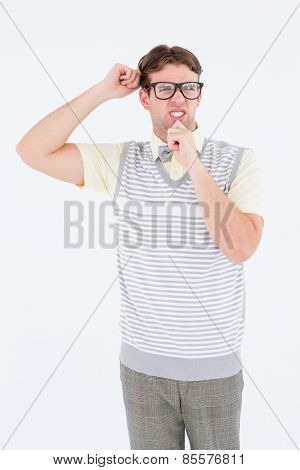 Geeky hipster thinking with hand on chin on white background