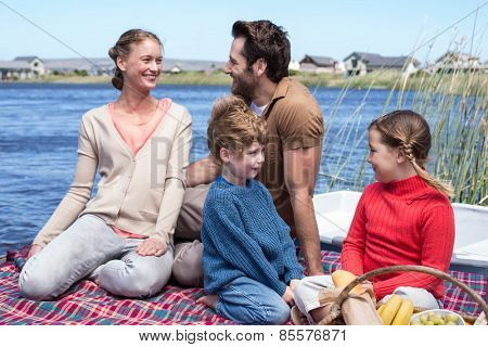 Happy family having picnic at a lake in the countryside