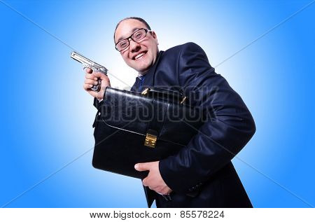 Businessman with gun isolated on white