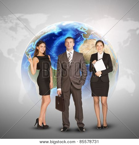 Business women and men in suits, smiling. Against background of globe, world map