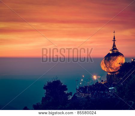 Vintage retro effect filtered hipster style image of Golden Rock - Kyaiktiyo Pagoda - famous Myanmar landmark, Buddhist pilgrimage site and tourist attraction, Myanmar