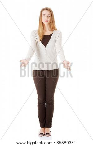 Full length sad woman with open hands gesture.