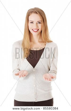 Happy woman with open hands gesture.