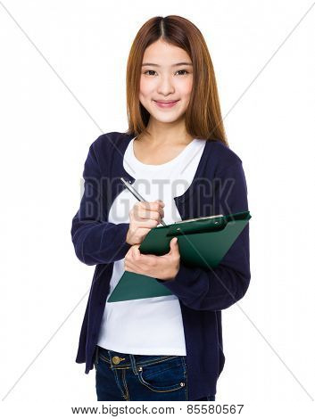 Young pretty woman write on clipboard