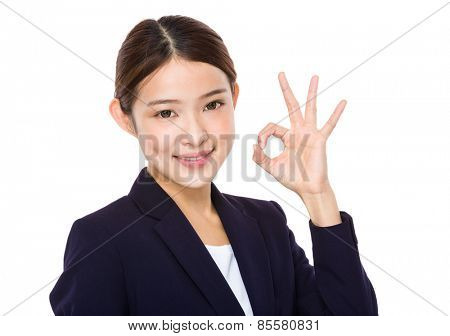 Beautiful businesswoman?showing okay sign