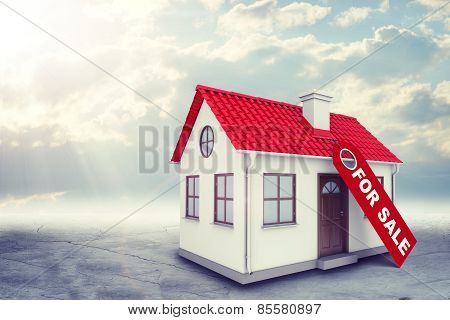 White house with label for sale, red roof and chimney. Background sun shines brightly