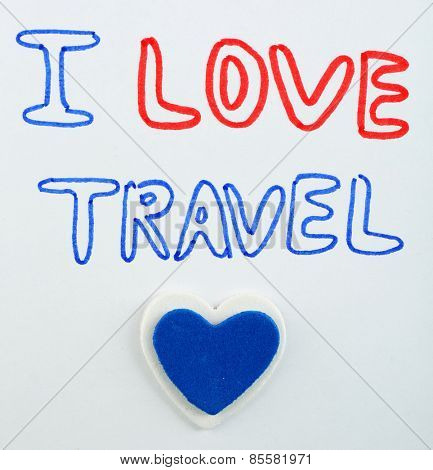 Inscription I love travel on paper close up