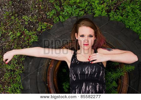 Girl Laying On Tire