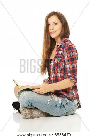 Woman sitting cross-legged and reading