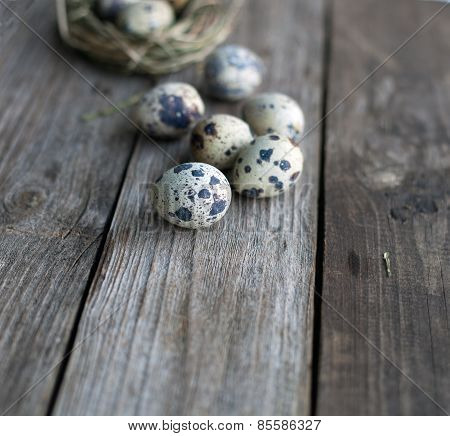 Quail Eggs On A Wooden Table