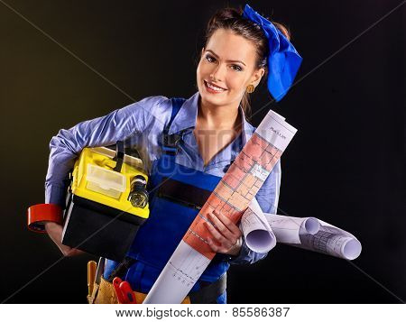 Builder woman with wallpaper. Black back ground