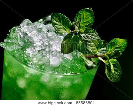 Green drink  with mint leaf on dark background. Top view.