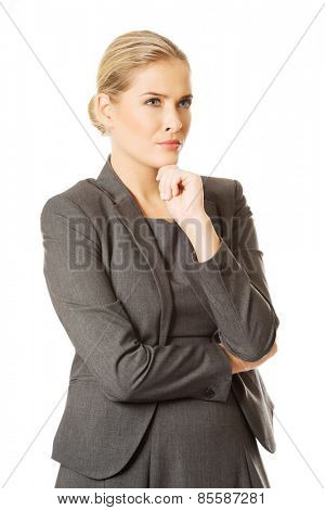 Businesswoman thinking about an idea