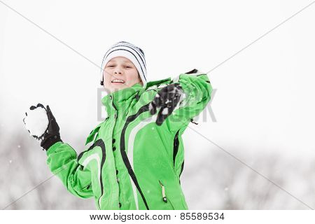 Young Boy Enjoying The Cold Winter Weather
