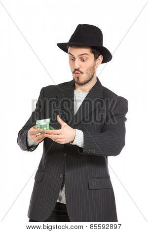 young man with hat counts the money, isolated over white background