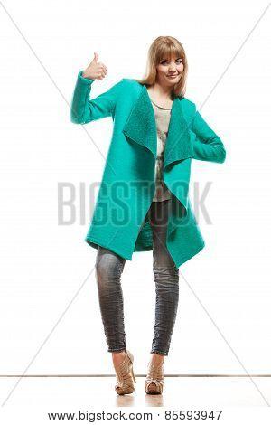 Woman Green Coat Making Thumb Up Sign