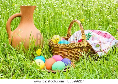 Easter Eggs, Basket, A Jug In The Grass