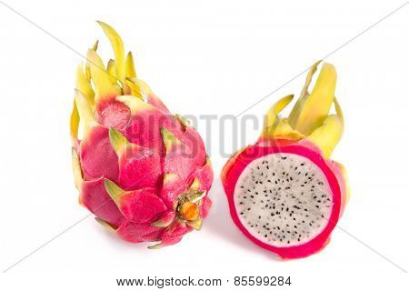 Whole and cut dragon fruits, isolated on white background