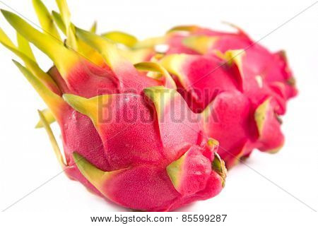 Three exotic dragon fruits, selective focus on first fruit, isolated on white background