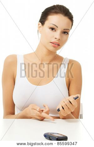 Diabetic woman checking her sugar level .
