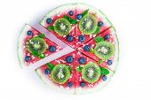 pic of watermelon  - Sliced juicy watermelon pizza isolated on white, closeup view from above. Ingredients are watermelon, blueberries, kiwi, mint, and coconut shavings.
