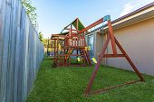 picture of swingset  - Wooden backyard play set in new Australian home - JPG