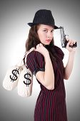stock photo of gangster  - Woman gangster with gun and money - JPG