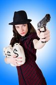 foto of handgun  - Woman gangster with handgun on white - JPG