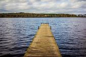 foto of pier a lake  - A wooden pier and lake seen in daylight  - JPG