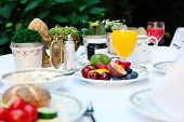 picture of continental food  - Outdoor continental breakfast at hotel - JPG