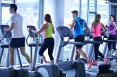 stock photo of treadmill  - group of young people running on treadmills in modern sport  gym - JPG