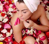 foto of beauty parlour  - Beautiful female in bath with rose petal - JPG