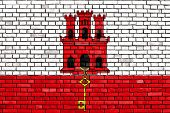 pic of gibraltar  - flag of Gibraltar painted on brick wall - JPG