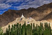 stock photo of jammu kashmir  - Shanti Stupa with view of Himalayan mountain and blue sky in background Ladakh Jammu and Kashmir India - JPG