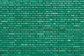 stock photo of green wall  - detail of an emerald green brick wall background - JPG