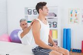picture of herniated disc  - Doctor examining his patient back in medical office - JPG