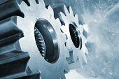 foto of titanium  - aerospace titanium gears and cogwheels against aluminum background - JPG
