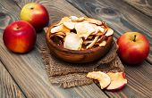 image of dry fruit  - dried apples and fresh fruits on a wooden background - JPG